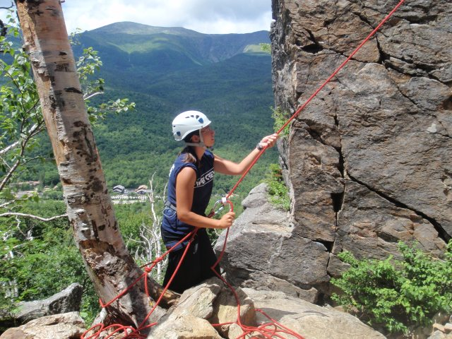 Crystal serves up some belay duty with a great back drop of Mt. Washington...