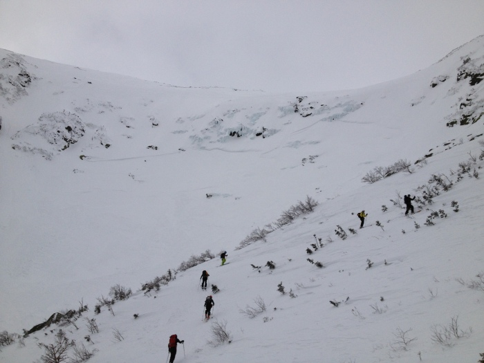 Spreading out and ascending up towards Right Gully