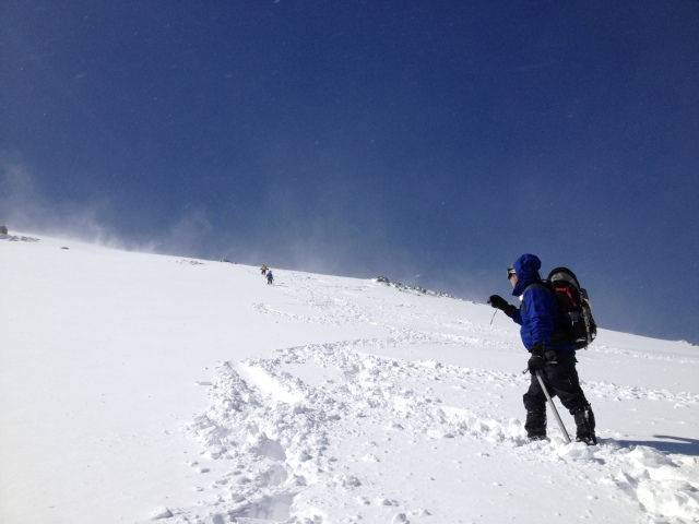 Romping down the summit snowfields in fresh powder...