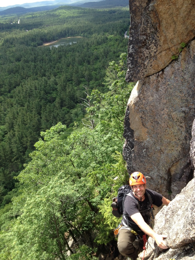 Chris reaching the belay on Pitch 2, Upper Refuse