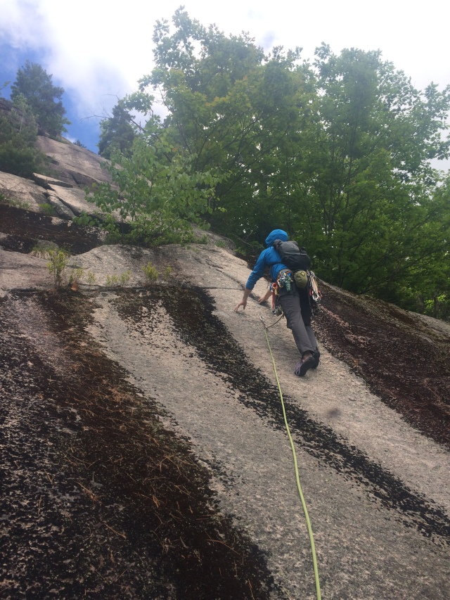 Tom starts up the 2nd Pitch of White Wonder, having just clipped the first bolt at 20'