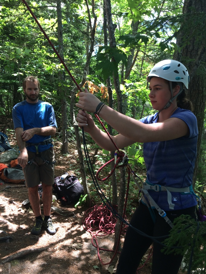 Mary works on the skills needed to escape a belay