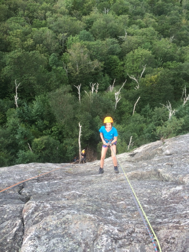 Vivian rappels the 150 foot West Face