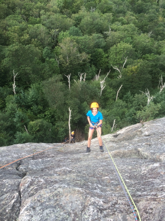 Vivian rappels the 150 foot West Face
